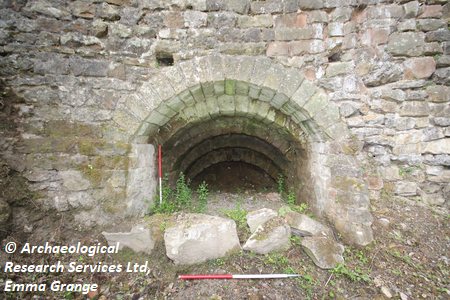 Photograph depicting the interior of the lime kiln facing south west with 2 x 1 m scales, taken during historical building recording at Plot 3, Jetting Street, Ashover, Derbyshire. Copyright: Archaeological Research Services Ltd, Emma Grange